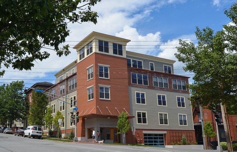 danforth on high - newly constructed apartment building with brick and vinyl exterior
