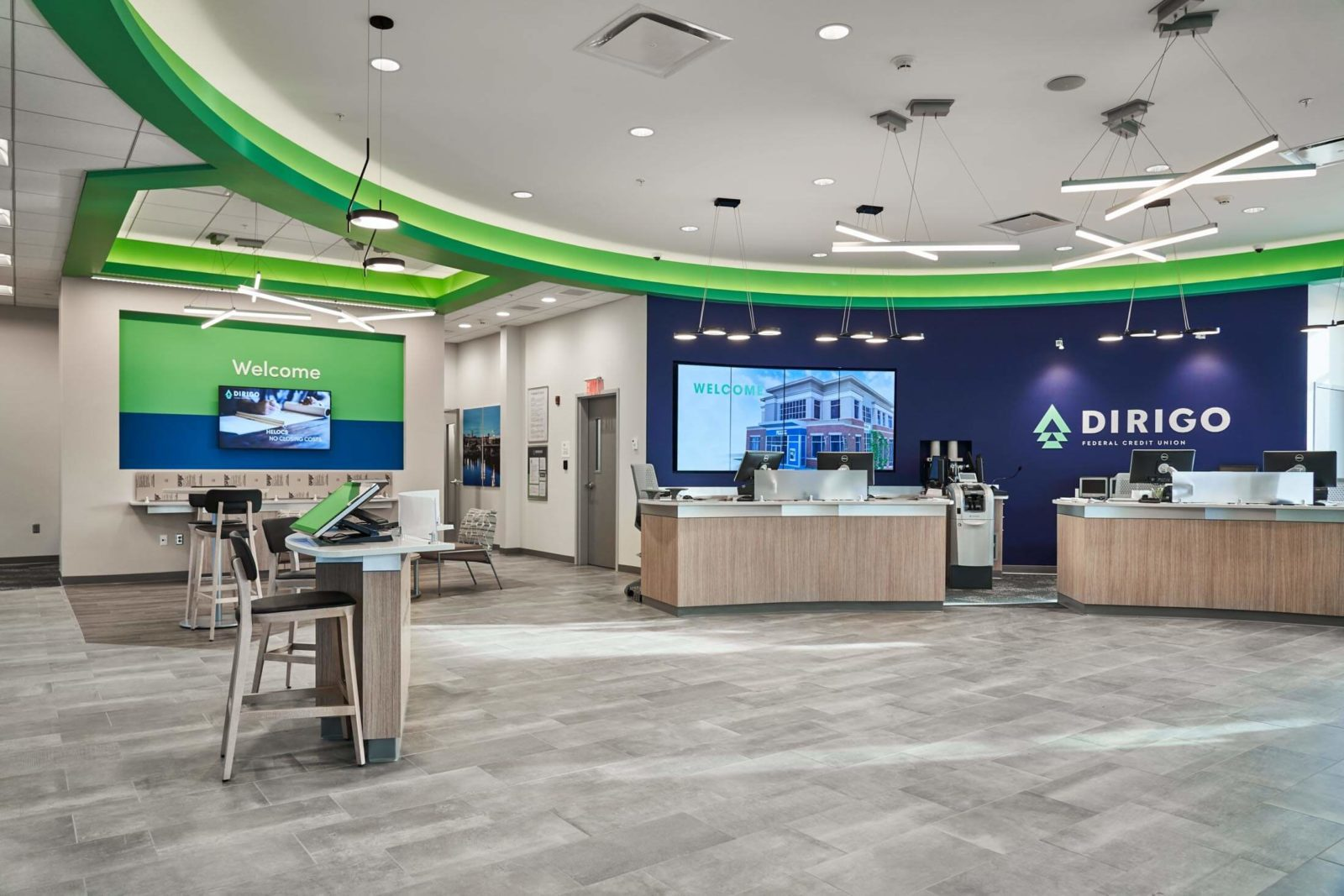 Dirigo federal credit union lobby area with tables and desks
